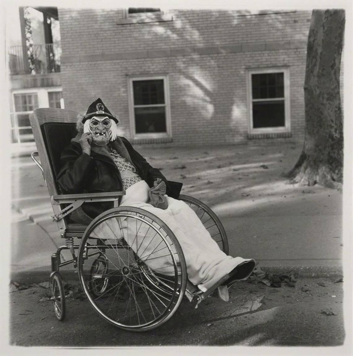 Diane Arbus, Masked woman in a wheelchair, PA. 1970