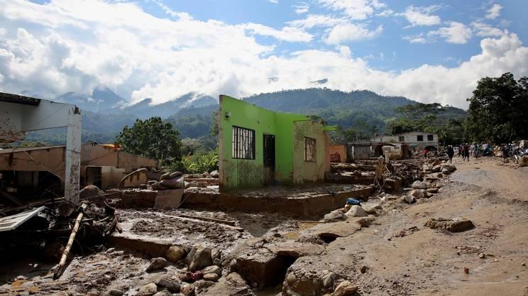 Case spazzate via dal fango
